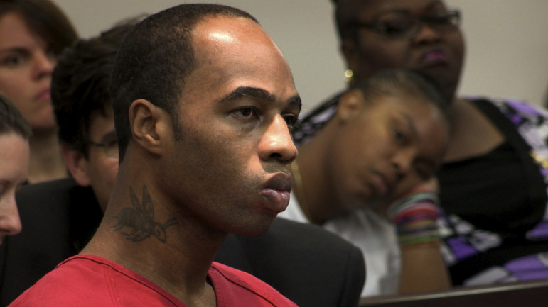 Kenneth Young at his resentencing hearing, with his mother and niece in the background.